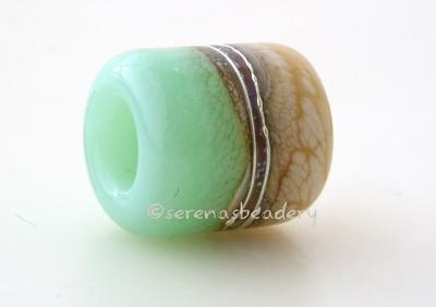 Seafoam Green Beach European Charm One european charm style bracelet bead with ivory, silvered ivory, fine silver and sea foam green.Bead Size:13x11 mmAmount:1 BeadHole Size:5 mm Glossy,Matte