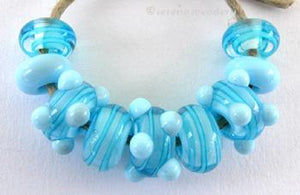 Sky Blue and Aqua Ribbon Spirals A set of nine beads in sky blue base with encased aqua ribbons and sky blue dots.6x12 mm Default Title