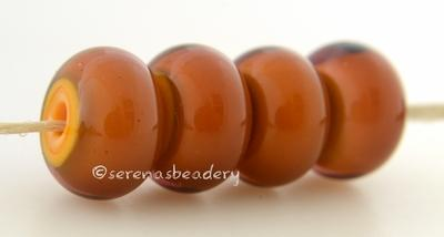 Squash Brown this is actually a layer of transparent amethyst glass over a squash yellow creating a gorgeous brown color6x12 mmprice is per bead Glossy,Matte