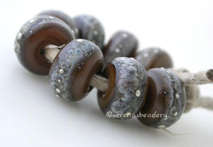 Tamarind Granite with Fine Silver Tamarind brown wrapped in silvered ivory and fine silver droplets. 5x11 mm 2.5 mm hole Price is per bead with discounts for larger quantities. Glossy,Matte