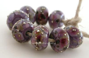 Peruvian Orchid Fine Silver Droplets Peruvian orchid frit beads with droplets of fine silver. I can create any style from my frit beads section with silver droplets like these. 5x11 mm Price is for 1 bead with discounts for larger quantity purchases. Glossy,Matte