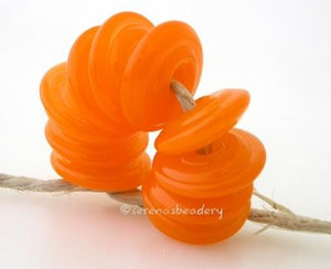 Translucent Orange Wavy Disk Spacer wavy disks in tanslucent orange2 sizes available: 11-12 mm with 1.5 mm hole or 13-14 mm with 2.5 mm holeprice is per 1 disk 11-12 mm 1.5 mm hole,12-13 mm 2.5 mm hole