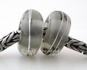 Transparent Grey Fine Silver Wrap European Charm Bead one transparent grey handmade lampwork glass european charm spacer bead with a fine silver wrap5x13mm with a 5mm holeprice is per bead Glossy,Matte