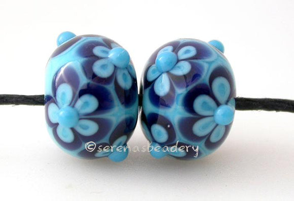 Turquoise and Blue Flowers a pair of turquoise blue beads with blue and turquoise flowers 6x12 mm    Glossy,Matte