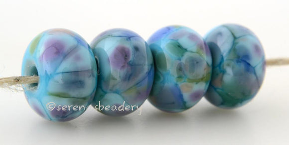 Fairly Demure LTD Light turquoise lampwork glass beads with purple, peach, blue, and green frit. Bead Size: 6x12 mm Hole Size: 2.5 mm     Glossy,Matte