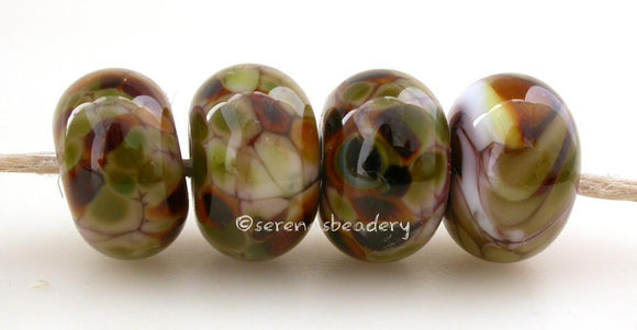 Psyched Violet purple lampwork glass beads with cream nougat, brown, and green frit.Bead Size: 6x11-12 or 7x13-14 mmHole Size: 2.5 mmprice is for one bead with a discount for 4 or more 11-12 mm,Glossy,13-14 mm,Glossy,11-12 mm,Matte,13-14 mm,Matte