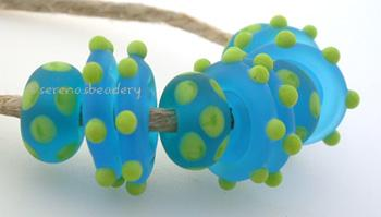 Beach Fun a set of pea green dotted aqua disks and donuts with a matte finishdonuts are 5x11mm and wavy disks are 3x14 mmset includes 4 donut dice dots and 6 wavy disks Default Title