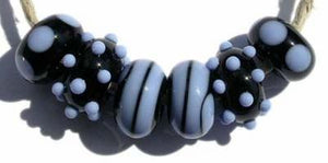 Chloe 6 black and periwinkle beads with spirals, mini dots and spots5x11 mmAvailable in a variety of colors. Black with your choice from the drop down menu. Glossy,1204 White,Glossy,1212 Pea Green,Glossy,1213 Mint Green,Glossy,1219 Copper Green,Glossy,1220 Periwinkle,Glossy,1221 Lavender,Glossy,1222 Dark Periwinkle,Glossy,1224 Light Sky Blue,Glossy,1232 Light Turquoise,Glossy,1247 Lavender Blue,Glossy,1248 Light Grey,Glossy,1260BG Bubblegum Pink,Glossy,1264 Ivory,Glossy,1414 Butternut,Glossy,1416 Bright Aci