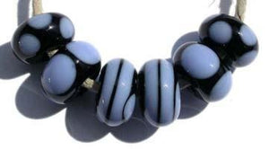 Dierdre 6 black and periwinkle beads with spirals and dots 5x11 mmAvailable in a variety of colors. Black with your choice from the drop down menu. Glossy,1204 White,Glossy,1212 Pea Green,Glossy,1213 Mint Green,Glossy,1219 Copper Green,Glossy,1220 Periwinkle,Glossy,1221 Lavender,Glossy,1222 Dark Periwinkle,Glossy,1224 Light Sky Blue,Glossy,1232 Light Turquoise,Glossy,1247 Lavender Blue,Glossy,1248 Light Grey,Glossy,1260BG Bubblegum Pink,Glossy,1264 Ivory,Glossy,1414 Butternut,Glossy,1416 Bright Acid Yellow,