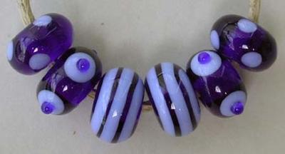 Robust a robust set 6 beads with spiral stripes and dots the above beads are cobalt and periwinkle 6x11 mm Also available in the following colors: teal-copper green amethyst- violet denim blue-pearly grey emerald- pea green amber- squash yellow Glossy,Cobalt-Periwinkle,Glossy,Teal-Copper Green,Glossy,Amethyst-Violet,Glossy,Emerald-Pea Green,Glossy,Amber-Squash Yellow,Matte,Cobalt-Periwinkle,Matte,Teal-Copper Green,Matte,Amethyst-Violet,Matte,Emerald-Pea Green,Matte,Amber-Squash Yellow