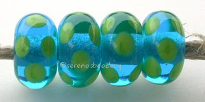 Aqua Pea Green Dice Dots An aqua base with pea green dice dots. 5x11 mm price is per bead Glossy,Matte