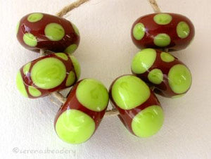 Brown and Pea Green Dot Set a set of six bead with a brown base and pea green dots 5x11 mm price is per set of beads Glossy,Matte