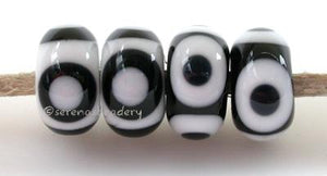 Black and White Eye Dots white beads with black and white round dots or black beads with white and black round dots 5x11 mm if you choose to reverse the colors, you will get the ones on the right price is per bead Glossy,No,Glossy,Yes,Matte,No,Matte,Yes