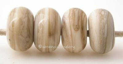 Fossil Color Notes: organic blend of ivory and brown 5x10 mm Available shapes and sizes:Round Bead Shapes: Available to order 8 to 15 mm with hole sizes ranging from 1.5 to 5 mm. See drop down menu for the exact options. Shown here in 8, 9 and 10 mm with both a 2.5 mm and 1.5 mm hole. 4 and 5 mm holes will fit European Charm style jewelry.Also available in a wavy disk or bead cap:. Pressed bead shapes:Lentil - 12x13 mm in size with a 1.5mm hole.: Pillow 13 mm square with a 1.5 mm hole.: Tab: Default Title