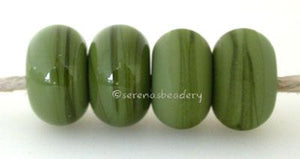 Olive Opaque Color Notes: Available shapes and sizes:Round Bead Shapes: Available to order 8 to 15 mm with hole sizes ranging from 1.5 to 5 mm. See drop down menu for the exact options. Shown here in 8, 9 and 10 mm with both a 2.5 mm and 1.5 mm hole. 4 and 5 mm holes will fit European Charm style jewelry.Also available in a wavy disk or bead cap:. Pressed bead shapes:Lentil - 12x13 mm in size with a 1.5mm hole.: Pillow 13 mm square with a 1.5 mm hole.: Tab: Default Title