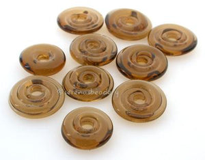 Dark Smoke Topaz Wavy Disk Spacer  10 wavy disks in a dark smoke topaz2 sizes available: 11-12 mm with 1.5 mm hole or 13-14 mm with 2.5 mm holeprice is per 10 disks 11-12 mm 1.5 mm hole,12-13 mm 2.5 mm hole