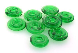 Light Emerald Green Wavy Disk Spacer  10 wavy disks in light emerald green2 sizes available: 11-12 mm with 1.5 mm hole or 13-14 mm with 2.5 mm holeprice is per 10 disks 11-12 mm 1.5 mm hole,12-13 mm 2.5 mm hole