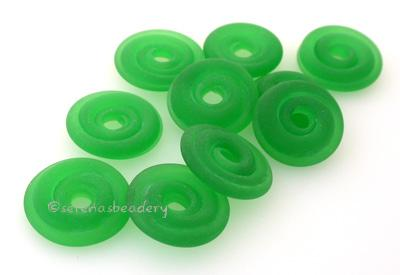 Light Emerald Matte Green Wavy Disk Spacer  10 wavy disks in light emerald green with a matte finish2 sizes available: 11-12 mm with 1.5 mm hole or 13-14 mm with 2.5 mm holeprice is per 10 disks 11-12 mm 1.5 mm hole,12-13 mm 2.5 mm hole