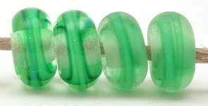 Grass Green Ribbon Color Notes: grass green ribbon cased in clear 5x10 mm Available shapes and sizes:Round Bead Shapes: Available to order 8 to 15 mm with hole sizes ranging from 1.5 to 5 mm. See drop down menu for the exact options. Shown here in 8, 9 and 10 mm with both a 2.5 mm and 1.5 mm hole. 4 and 5 mm holes will fit European Charm style jewelry.Also available in a wavy disk or bead cap:. Pressed bead shapes:Lentil - 12x13 mm in size with a 1.5mm hole.: Pillow 13 mm square with a 1.5 mm hole.: Tab: De
