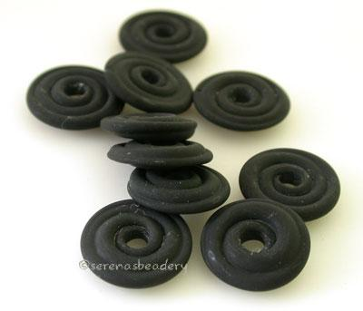 Black Matte Wavy Disk Spacer  10 wavy disks in black in a matte finish2 sizes available: 11-12 mm with 1.5 mm hole or 13-14 mm with 2.5 mm holeprice is per 10 disks 11-12 mm 1.5 mm hole,12-13 mm 2.5 mm hole