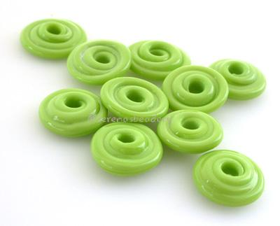 Pea Green Wavy Disk Spacer  10 wavy disks in pea green2 sizes available: 11-12 mm with 1.5 mm hole or 13-14 mm with 2.5 mm holeprice is per 10 disks 11-12 mm 1.5 mm hole,12-13 mm 2.5 mm hole