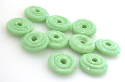 Mint Green Wavy Disk Spacer 10 wavy disks in mint green2 sizes available: 11-12 mm with 1.5 mm hole or 13-14 mm with 2.5 mm holeprice is per 10 disks 11-12 mm 1.5 mm hole,12-13 mm 2.5 mm hole