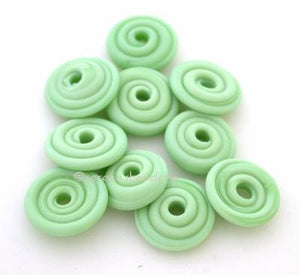 Mint Green Matte Wavy Disk Spacer 10 wavy disks in mint green with a matte finish2 sizes available: 11-12 mm with 1.5 mm hole or 13-14 mm with 2.5 mm holeprice is per 10 disks 11-12 mm 1.5 mm hole,12-13 mm 2.5 mm hole