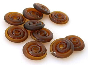 Transparent Brown Tumbled Wavy Disk Spacer  10 tumbled wavy disks in transparent brown2 sizes available: 11-12 mm with 1.5 mm hole or 13-14 mm with 2.5 mm holeprice is per 10 disks 11-12 mm 1.5 mm hole,12-13 mm 2.5 mm hole