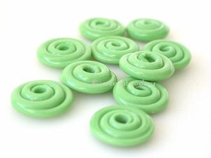 Nile Green Wavy Disk Spacer 10 wavy disks in nile green2 sizes available: 11-12 mm with 1.5 mm hole or 13-14 mm with 2.5 mm holeprice is per 10 disks 11-12 mm 1.5 mm hole,12-13 mm 2.5 mm hole
