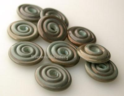 Dirty Copper Green Wavy Disk Spacer 10 wavy disks in dirty copper green2 sizes available: 11-12 mm with 1.5 mm hole or 13-14 mm with 2.5 mm holeprice is per 10 disks 11-12 mm 1.5 mm hole,12-13 mm 2.5 mm hole