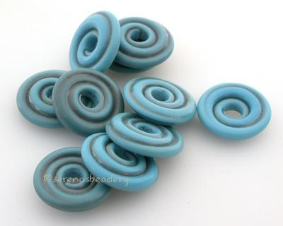 Dark Turquoise Tumbled Wavy Disk Spacer 10 tumbled wavy disks in dark turquoise2 sizes available: 11-12 mm with 1.5 mm hole or 13-14 mm with 2.5 mm holeprice is per 10 disks 11-12 mm 1.5 mm hole,12-13 mm 2.5 mm hole