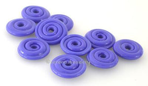 Light Cobalt Wavy Disk Spacer 10 wavy disks in light cobalt2 sizes available: 11-12 mm with 1.5 mm hole or 13-14 mm with 2.5 mm holeprice is per 10 disks 11-12 mm 1.5 mm hole,12-13 mm 2.5 mm hole