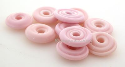 Dark Pink Wavy Disk Spacer 10 wavy disks in dark pink2 sizes available: 11-12 mm with 1.5 mm hole or 13-14 mm with 2.5 mm holeprice is per 10 disks 11-12 mm 1.5 mm hole,12-13 mm 2.5 mm hole