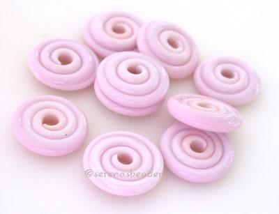 Bubble Gum Pink Wavy Disk Spacer 10 wavy disks in bubble gum pink2 sizes available: 11-12 mm with 1.5 mm hole or 13-14 mm with 2.5 mm holeprice is per 10 disks 11-12 mm 1.5 mm hole,12-13 mm 2.5 mm hole