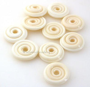 Light Ivory Wavy Disk Spacer 10 wavy disks in light ivory2 sizes available: 11-12 mm with 1.5 mm hole or 13-14 mm with 2.5 mm holeprice is per 10 disks 11-12 mm 1.5 mm hole,12-13 mm 2.5 mm hole