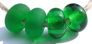 Dark Emerald Color Notes: transparent dark emerald green 5x10 mm Available shapes and sizes:Round Bead Shapes: Available to order 8 to 15 mm with hole sizes ranging from 1.5 to 5 mm. See drop down menu for the exact options. Shown here in 8, 9 and 10 mm with both a 2.5 mm and 1.5 mm hole. 4 and 5 mm holes will fit European Charm style jewelry.Also available in a wavy disk or bead cap:. Pressed bead shapes:Lentil - 12x13 mm in size with a 1.5mm hole.: Pillow 13 mm square with a 1.5 mm hole.: Tab: Default Tit