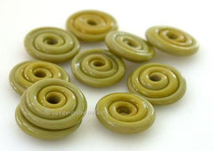 Wasabi Wavy Disk Spacer 10 wavy disks in wasabi green2 sizes available: 11-12 mm with 1.5 mm hole or 13-14 mm with 2.5 mm holeprice is per 10 disks 11-12 mm 1.5 mm hole,12-13 mm 2.5 mm hole