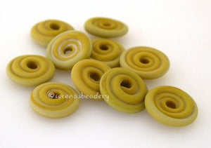 Wasabi Matte Wavy Disk Spacer 10 wavy disks in wasabi green with a matte finish2 sizes available: 11-12 mm with 1.5 mm hole or 13-14 mm with 2.5 mm holeprice is per 10 disks 11-12 mm 1.5 mm hole,12-13 mm 2.5 mm hole