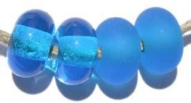 Dark Aqua Color Notes: transparent dark aqua 5x10 mm Available shapes and sizes:Round Bead Shapes: Available to order 8 to 15 mm with hole sizes ranging from 1.5 to 5 mm. See drop down menu for the exact options. Shown here in 8, 9 and 10 mm with both a 2.5 mm and 1.5 mm hole. 4 and 5 mm holes will fit European Charm style jewelry.Also available in a wavy disk or bead cap:. Pressed bead shapes:Lentil - 12x13 mm in size with a 1.5mm hole.: Pillow 13 mm square with a 1.5 mm hole.: Tab: Default Title