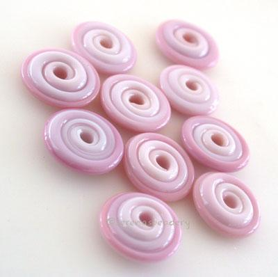 Flower Pink Medium Wavy Disk Spacer 10 wavy disks in flower pink medium2 sizes available: 11-12 mm with 1.5 mm hole or 13-14 mm with 2.5 mm holeprice is per 10 disks 11-12 mm 1.5 mm hole,12-13 mm 2.5 mm hole