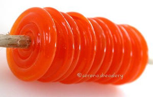 Tangerine Sparkle Wavy Disk Spacer 10 wavy disks in tangerine sparkle, an odd lot glass with glitter in a matte finish2 sizes available: 11-12 mm with 1.5 mm hole or 13-14 mm with 2.5 mm holeprice is per 10 disks 11-12 mm 1.5 mm hole,12-13 mm 2.5 mm hole
