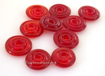 Red Candy Apple Wavy Disk Spacer 10 wavy disks in candy apple red, an odd lot of glass2 sizes available: 11-12 mm with 1.5 mm hole or 13-14 mm with 2.5 mm holeprice is per 10 disks 11-12 mm 1.5 mm hole,12-13 mm 2.5 mm hole