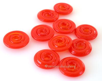 Red Carrot Sparkle Wavy Disk Spacer 10 wavy disks in red carrot, an odd lot of glass with glitter2 sizes available: 11-12 mm with 1.5 mm hole or 13-14 mm with 2.5 mm holeprice is per 10 disks 11-12 mm 1.5 mm hole,12-13 mm 2.5 mm hole