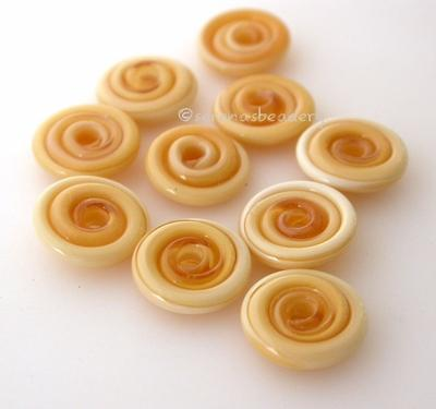 Honey Crunch Wavy Disk Spacer 10 wavy disks in honey crunch, an odd lot of glass2 sizes available: 11-12 mm with 1.5 mm hole or 13-14 mm with 2.5 mm holeprice is per 10 disks 11-12 mm 1.5 mm hole,12-13 mm 2.5 mm hole