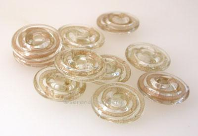 Gold Adventurine Ribbon Wavy Disk Spacer 10 wavy disks in goldstone ribbon2 sizes available: 11-12 mm with 1.5 mm hole or 13-14 mm with 2.5 mm holeprice is per 10 disks 11-12 mm 1.5 mm hole,12-13 mm 2.5 mm hole