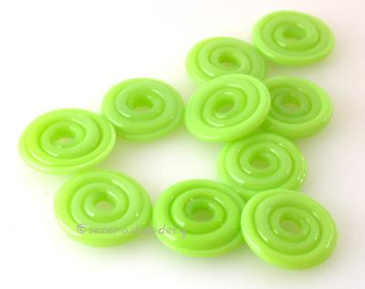 Neon Spring Green Wavy Disk Spacer 10 wavy disks in neon spring green2 sizes available: 11-12 mm with 1.5 mm hole or 13-14 mm with 2.5 mm holeprice is per 10 disks 11-12 mm 1.5 mm hole,12-13 mm 2.5 mm hole