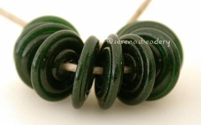 Aventurine Green Wavy Disk Spacer 10 wavy disks in aventurine green glitter2 sizes available: 11-12 mm with 1.5 mm hole or 13-14 mm with 2.5 mm holeprice is per 10 disks 11-12 mm 1.5 mm hole,12-13 mm 2.5 mm hole
