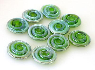 Green Lustre Wavy Disk Spacer 10 wavy disks in green lustre2 sizes available: 11-12 mm with 1.5 mm hole or 13-14 mm with 2.5 mm holeprice is per 10 disks 11-12 mm 1.5 mm hole,12-13 mm 2.5 mm hole