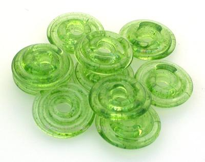 Seaweed Aventurine Wavy Disk Spacer 10 wavy disks in seaweed aventurine2 sizes available: 11-12 mm with 1.5 mm hole or 13-14 mm with 2.5 mm holeprice is per 10 disks 11-12 mm 1.5 mm hole,12-13 mm 2.5 mm hole