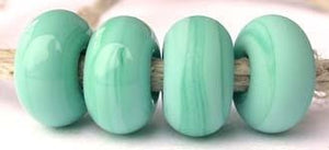 Pale Turquoise Color Notes: Available shapes and sizes:Round Bead Shapes: Available to order 8 to 15 mm with hole sizes ranging from 1.5 to 5 mm. See drop down menu for the exact options. Shown here in 8, 9 and 10 mm with both a 2.5 mm and 1.5 mm hole. 4 and 5 mm holes will fit European Charm style jewelry.Also available in a wavy disk or bead cap:. Pressed bead shapes:Lentil - 12x13 mm in size with a 1.5mm hole.: Pillow 13 mm square with a 1.5 mm hole.: Tab: Default Title